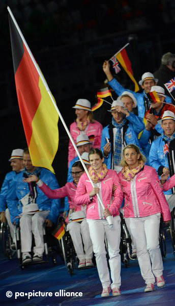 Germany's flag bearer Daniela Schulte (front) leads the team during the Opening Ceremony of the London 2012 Paralympic Games at the Olympic stadium, London, Great Britain, 29 August 2012. Photo: Julian Stratenschulte dpa